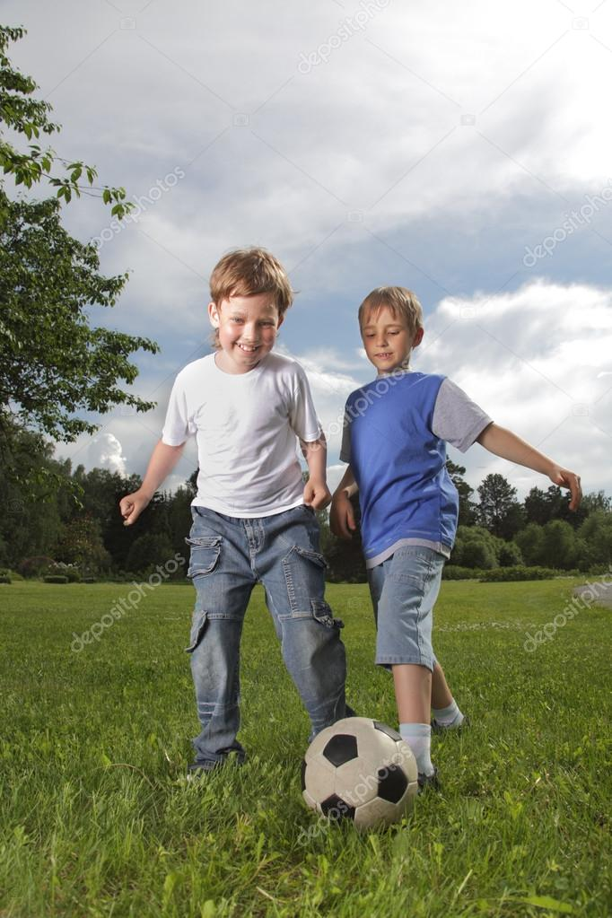 two happy boy play in soccer