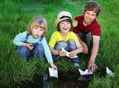 Photo three boy play in  stream