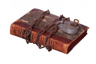 rusty chain and padlock on old book
