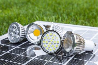 various GU10 LED bulbs on photovoltaics in the grass