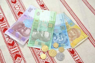 The Ukrainian money against the embroidered towel