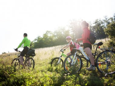 family cycling outdoors
