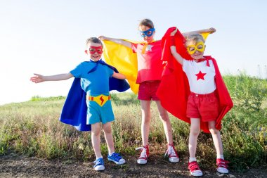 children  acting like a super hero