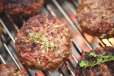 Food meat - beef burgers on bbq barbecue grill with flame