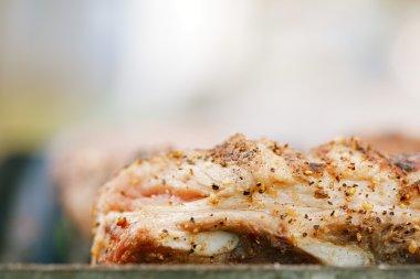 marinated juicy pork ribs on grill
