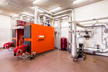 interior industrial diesel boiler room with boilers and burners