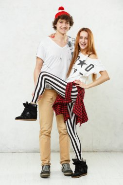 Man and woman standing on a white floor and white background foo