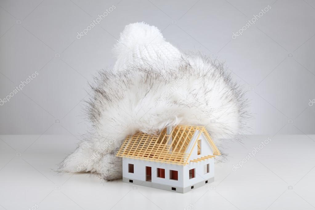 Cap isolate model of rough construction house against heat leak - unfinished house insulation concept. Prepare rough construction for winter concept.
