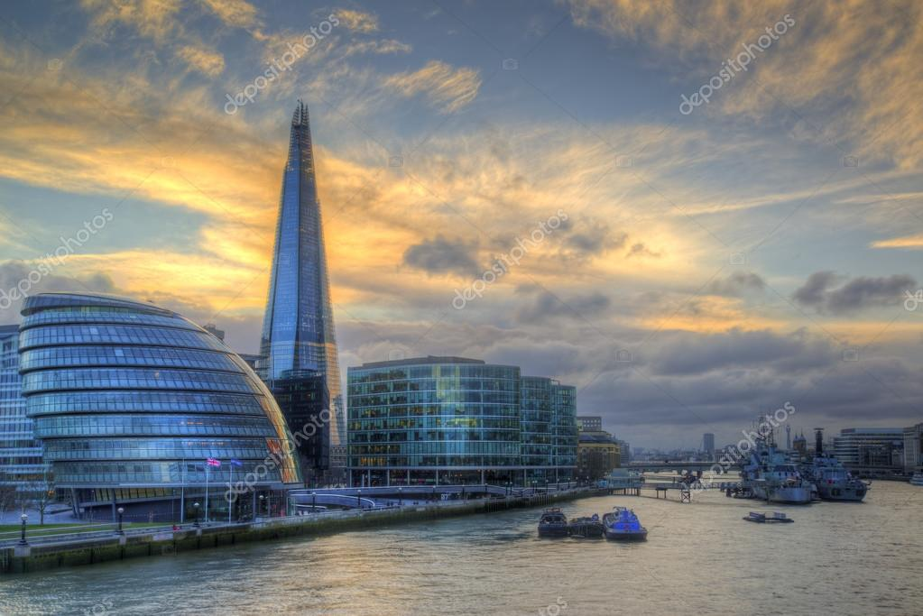 London City skyline along River Thames during vibrant sunset