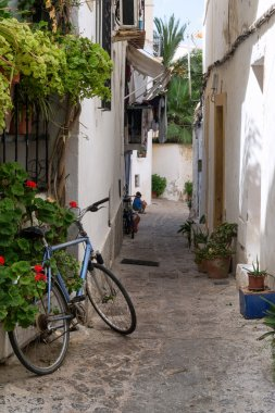 Typical old Mediterranean alley between old houses with bike abn
