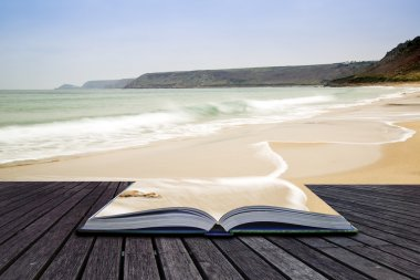 Creative concept pages of book Sennen Cove beach before sunset i