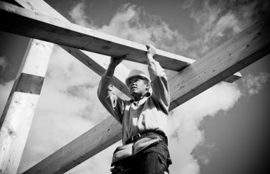 Construction Worker with timber
