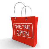 jsme otevřené nákupní taška ukazuje nové úložiště spuštění