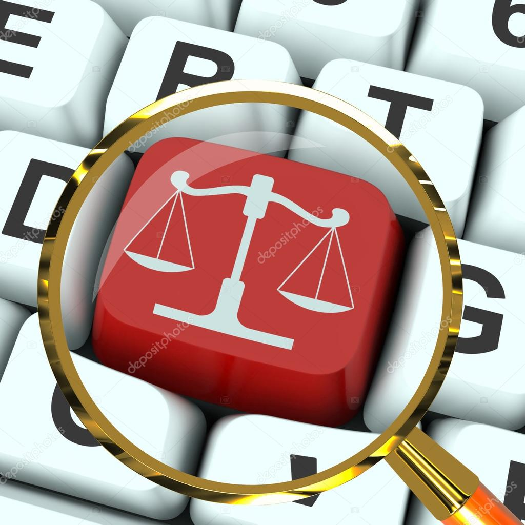 Scales Of Justice Key Magnified Means Law Trial Stock Photo