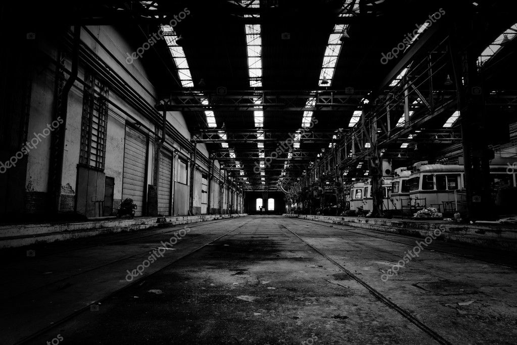 Interior of a vehicle repair station in black and white
