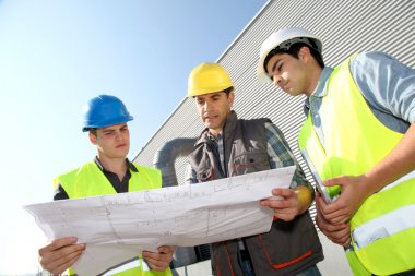 Young in professional training on industrial site