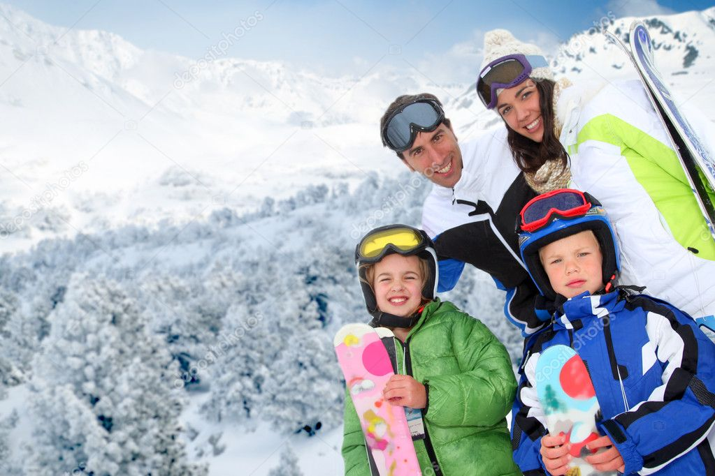 Family of four at the mountain in winter