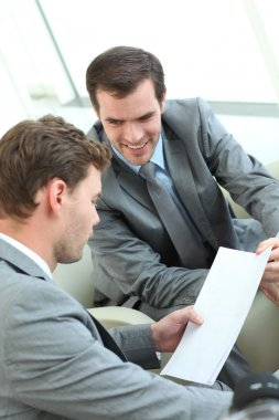 Businessmen discussing conditions of contract stock vector