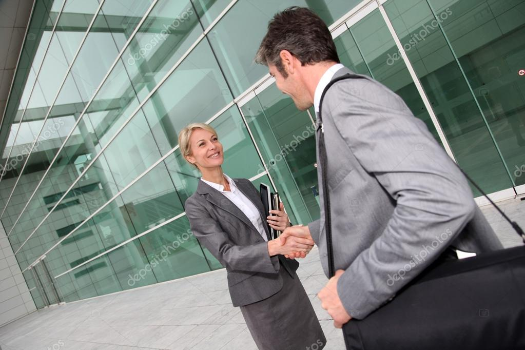 Business shaking hands after meeting