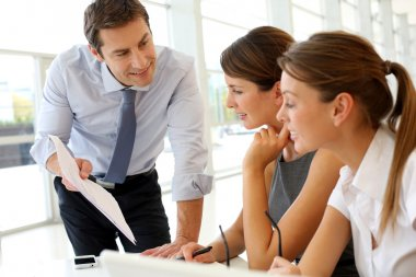 Manager presenting business plan to employees stock vector