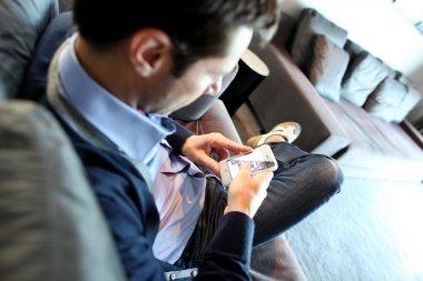 Man sending short message with smartphone