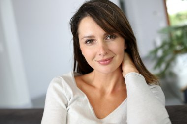 Portrait of attractive brunette woman looking at camera