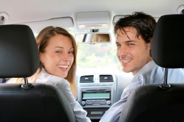 Back view of couple driving car