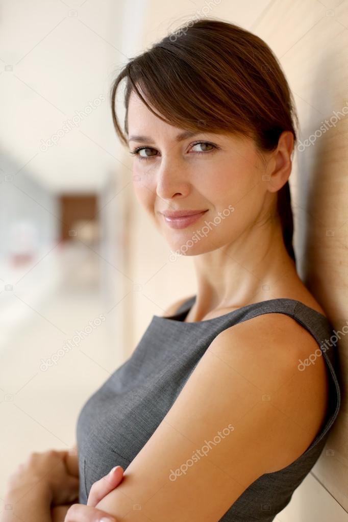Portrait of elegant businesswoman standing in hallway