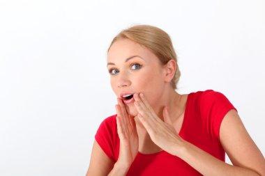 Portrait of blond woman whispering