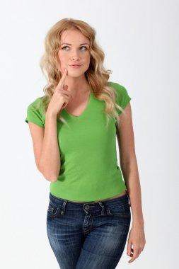 Woman with green shirt having warning attitude