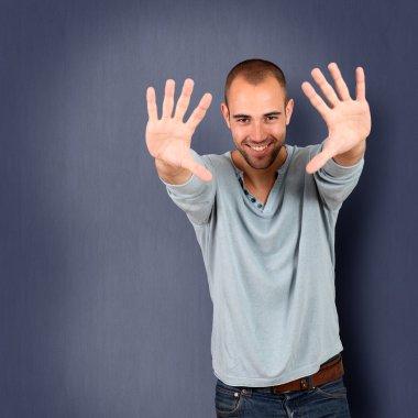 Handsome man showing hands up