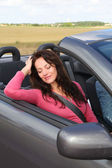 Photo Portrait of woman in convertible car