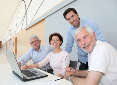 Group of senior attending job search meeting