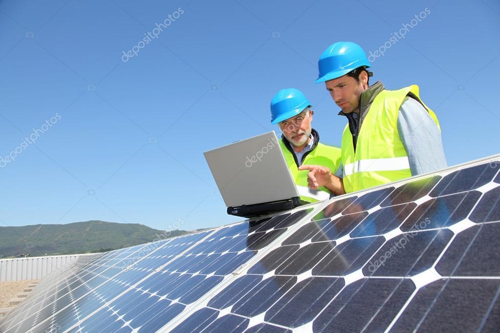 Engineers checking solar panel setup — Stock Photo © Goodluz