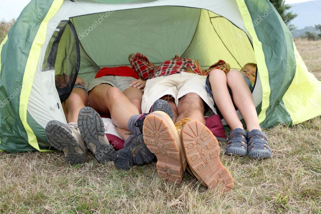 View of feet from outside a camp tent