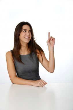 Smiling woman pointing at message board