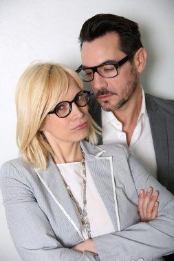 Trendy couple with eyeglasses on white background