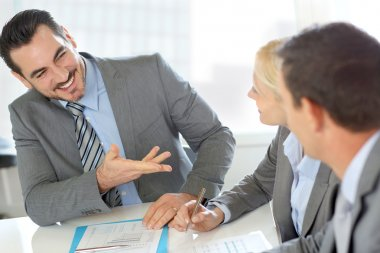 Businessman presenting contract to partners