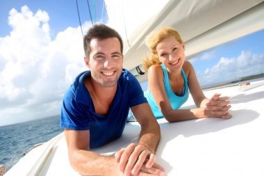 Cheerful couple cruising on a sail boat