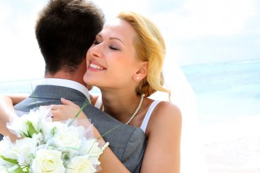 Bride embracing her groom stock vector