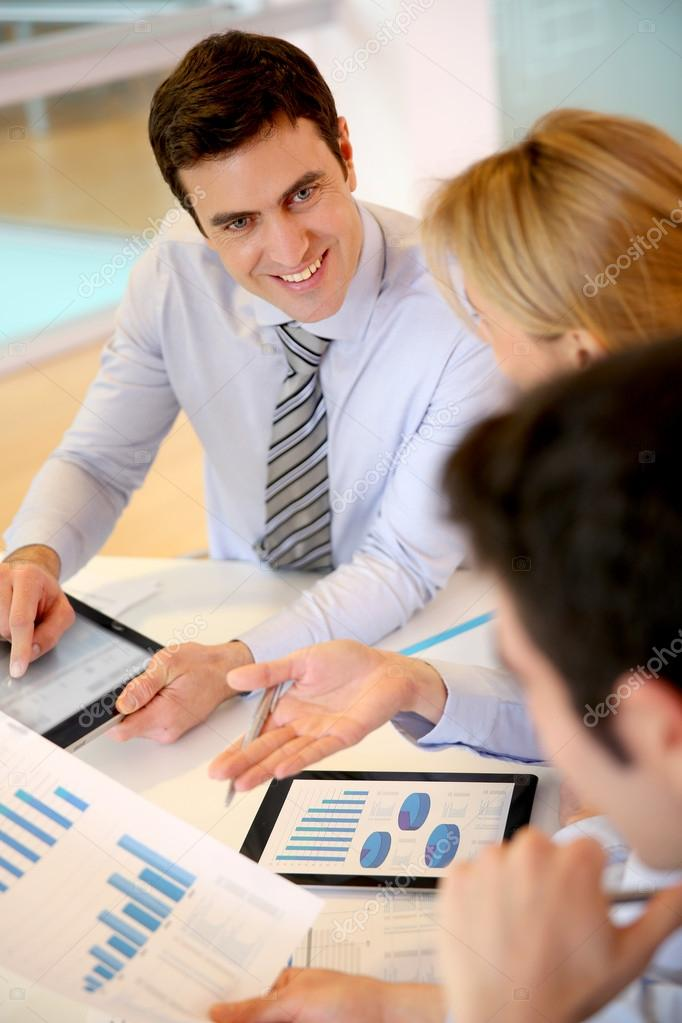 sales director presenting business plan to team stock photo
