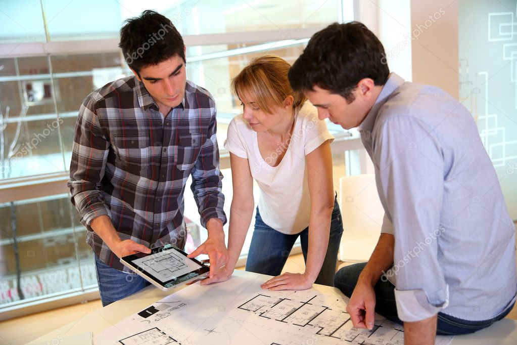 Startup business team working on blueprint