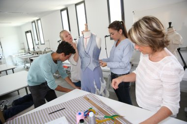 Students in dressmaking training school