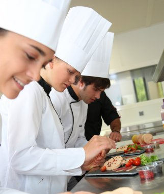 Chefs preparing delicatessen dishes