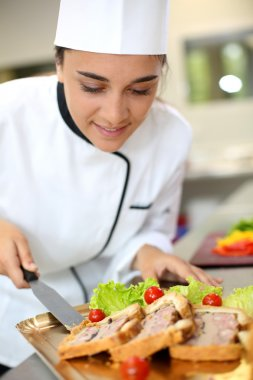 Caterer preparing food tray