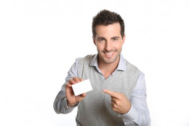 Smiling man showing card