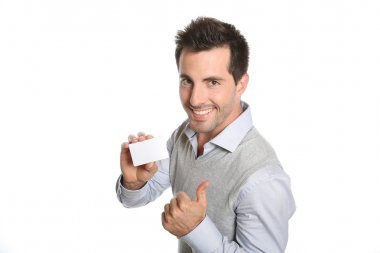 Man showing card with thumb up