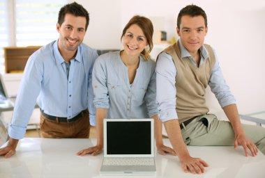 People showing laptop screen