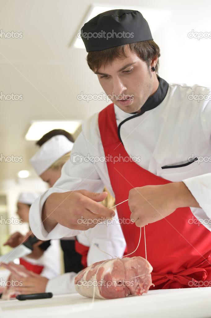 Young butcher — Stock Photo © Goodluz #35261631