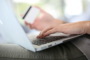 Hand holding credit card to buy online